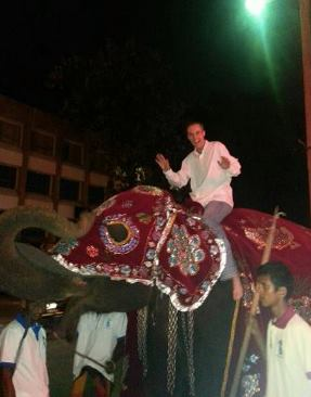 Here he is riding an elephant in Sri Lanka last year.