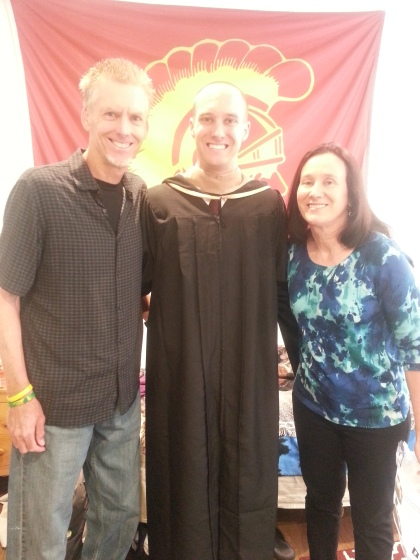 greg with parents graduation