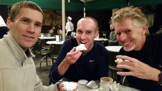 boys eating beignets